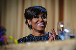 First Lady Michelle Obama reacts to a joke told by her husband President Barack Obama during the White House Correspondents' Association (WHCA) in Washington, District of Columbia, U.S., on Saturday, April 27, 2013. Photographer: Pete Marovich/Bloomberg