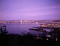 BI32,829-01...WASHINGTON - A 1965 photograph of sunset over Elliott Bay and the city of Seattle from West Seattle.