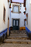 Europe, Portugal, Obidos. Romantic cobbled walkway of Obidos.