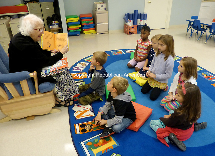 SOUTHBURY, CT-16 September 2013-091613BF03- Mia D'Eletto, a storyteller and librarian, reads to children during the Kinder Club Book Club program at the Southbury Public Library Monday afternoon. The program features stories without words for kindergarten aged children. Children from left Will Berry,5, Nate Berry,5, Teniola Arole, 5, Natalie Taylor, 5, Sadie DiDonato,6, Madelyn DiDonato,5, and Juliana Drago,4, listen to her read 'The Boy Who Bit Picasso' by Antony Penrose.   Bob Falcetti Republican-American