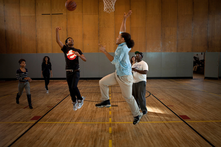 12th Graders Eric Hamilton, 16, left, and Brander Suero, 16, right, shoot hoops during physical education class in the gym at Central Park East High School in New York, NY on November 15, 2012. Beyond sheer physical safety, a look at how schools and districts can create classroom conditions in which students are able to engage enthusiastically and without emotional fear of stepping forward. Photographer: Melanie Burford/Prime