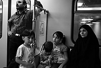 Teheran, Iran, October 3, 2007.In Teheran metro, people going to 'Behesht Zahra' (Zarha's Paradise), 15km south of the city, it is the largest cemetery in Teheran. More than 200 000 victims of the Iran-Iraq war are buried there, as well as heroes of the 1979 Revolution and ordinary people.