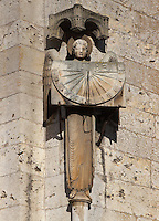 Romanesque sculpture of an angel holding a sundial at the Royal Portal, at the South Western corner of the cathedral, 1145-70, Western facade, Chartres cathedral, Eure-et-Loir, France. Chartres cathedral was built 1194-1250 and is a fine example of Gothic architecture. It was declared a UNESCO World Heritage Site in 1979. Picture by Manuel Cohen.