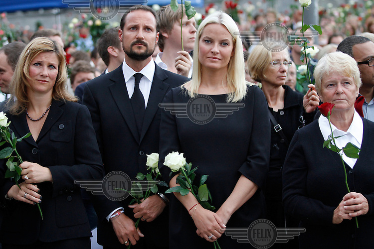 (Oslo July 25, 2011) Princess Märtha Louise, Crown Prince Haakon , HRH Mette-Marit and former PM Gro Harlem Brundtland listen to a speach. An estimated 150,000 people gathered in Oslo town centre for a vigil following Friday's twin extremist attacks ...A large vehicle bomb was detonated near the offices of Norwegian Prime Minister Jens Stoltenberg on 22 July 2011. .Another terrorist attack took place shortly afterwards, where a man killed 68 people, mainly children and youths attending a political camp at Utøya island. ..Anders Behring Breivik was arrested on the island and has admitted to carrying out both attacks..(photo:Fredrik Naumann/Felix Features)