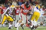 Ole Miss' Layton Jones (89) blocks LSU linebacker Seth Fruge (48) on a kickoff at Vaught-Hemingway Stadium in Oxford, Miss. on Saturday, November 19, 2011.