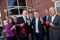 David Parsons, Leader of Leicestershire County Council (glasses) opens EMB's new office at Merus Court, Leicester, watched by EMB chief executive Stephen Smith