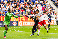 Jalil Anibaba (6) of the Chicago Fire attempts to shield Tim Cahill (17) of the New York Red Bulls from the ball during a Major League Soccer (MLS) match at Red Bull Arena in Harrison, NJ, on October 06, 2012.