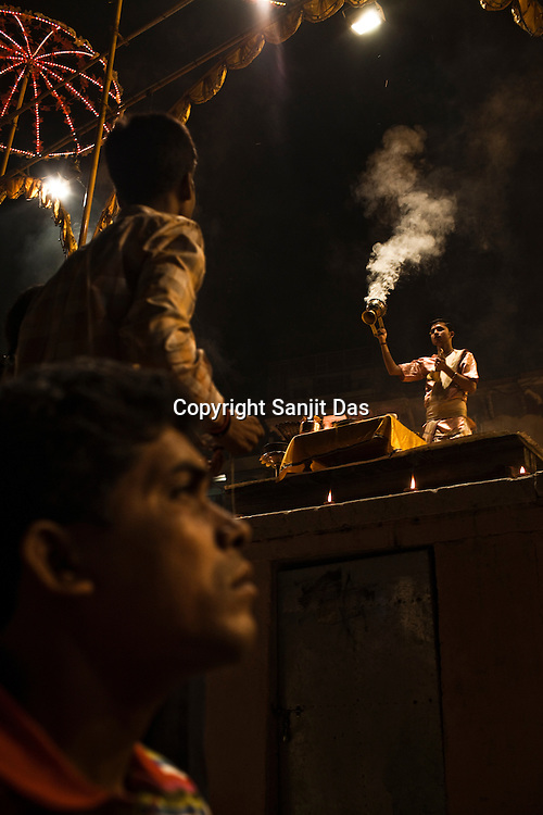 Pilgrims attend the evening prayers at the at the Dashashwamedh Ghat in the ancient city of Varanasi in Uttar Pradesh, India. Photograph: Sanjit Das/Panos