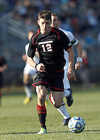 Northeastern University forward Don Anding (12) on the attack. .NCAA Tournament. University of Connecticut (white) defeated Northeastern University (black), 1-0, at Morrone Stadium at University of Connecticut on November 18, 2012.