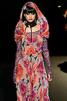Jacky walks runway in an Unforgettable outfit, from the Betsey Johnson Fall 2011 He Loves Me Not - Black Tag collection, during Mercedes-Benz Fashion Week Fall 2011.
