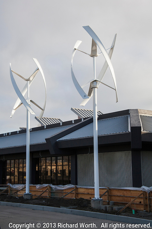 Two vertical axis wind turbines at the Zero Net Energy Center under construction in San Leandro, California.