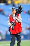 1 November 2009: Buffalo Bills team photographer Craig Melvin looks for subject matter during a game against the Houston Texans at Ralph Wilson Stadium in Orchard Park, New York, USA. The Texans defeated the Bills 31-10. Mandatory Credit: Ed Wolfstein Photo