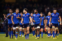 France players do a lap of the pitch after the match. Rugby World Cup Pool D match between France and Ireland on October 11, 2015 at the Millennium Stadium in Cardiff, Wales. Photo by: Patrick Khachfe / Onside Images