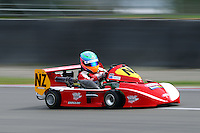 Karl Wilson, NZ, races in the International Superkarts class during the 2012 Superkart National Champs and Grand Prix at Manfeild in Feilding, New Zealand on Saturday, 7 January 2011. Credit: Hagen Hopkins.