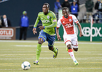 November, 2013: CenturyLink Field, Seattle, Washington: Seattle Sounders FC forward Eddie Johnson (7) and Portland Timbers midfielder Diego Chara (21) pursue the ball  as the Portland Timbers defeat  the Seattle Sounders FC 2-1 in the Major League Soccer Playoffs semifinals Round.