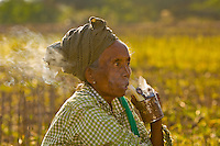 Woman smoking a pipe, Bagan, Myanmar (Burma)