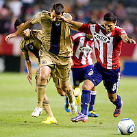 Philadelphia Union midfielder Stefani Miglioranzi (6) is punched in the face by CD Chivas USA defender Mariano Trujillo (8) while battling  for the ball. The Philadelphia Union and CD Chivas USA played to 1-1 draw at Home Depot Center stadium in Carson, California on Saturday evening July 3, 2010..