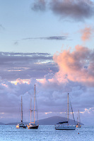Sailboats at anchor at dusk<br />