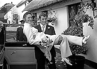 N Ireland international and Arsenal FC footballer,Terry Neill, with his bride, Sandra Lichfield, arriving at the reception in the Crawfordsburn Inn after their wedding in First Bangor Presbyterian Church, Bangor, Co Down, N Ireland, 4th November 1969. They met in March that year in Malta whilst Terry was touring with Arsenal and she was on a modelling assignment. 196911040256b<br />