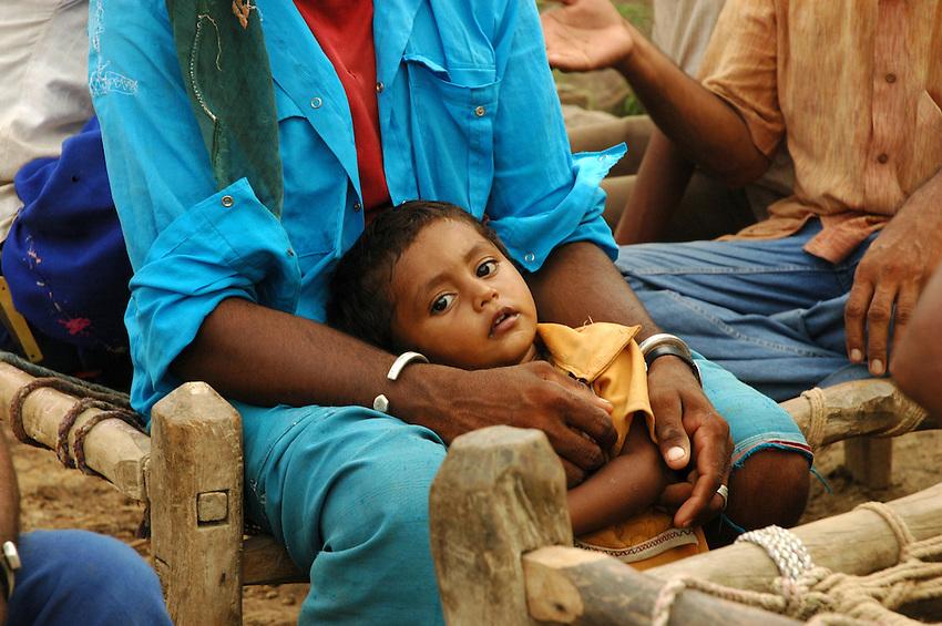 Maldhari boy in his father's hands..Michael Benanav - mbenanav@gmail.com