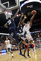 Ohio State's Lenzelle Smith, Jr. (32) shoots over North Florida's Travis Wallace (1) and North Florida's Demarcus Daniels (32) during the first half Friday, Nov. 29, 2013, in Columbus, Ohio. (Photo by Terry Gilliam)