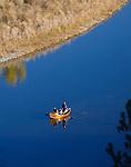 Fishermen in a drift boat on the Clark Fork River outside of Missoula, Montana