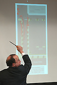 Defense attorney Peter Greenspun gestures as he points to a diagram of the area where Sarah Ramos was killed in the Leisure World Shopping Center in Silver Spring, Maryland displayed on a screen during the trial of sniper suspect John allen Muhammad in courtroom 10 at the Virginia Beach Circuit Court in Virginia Beach, Virginia on October 28, 2003.  <br /> Credit: Adrin Snider - Pool via CNP