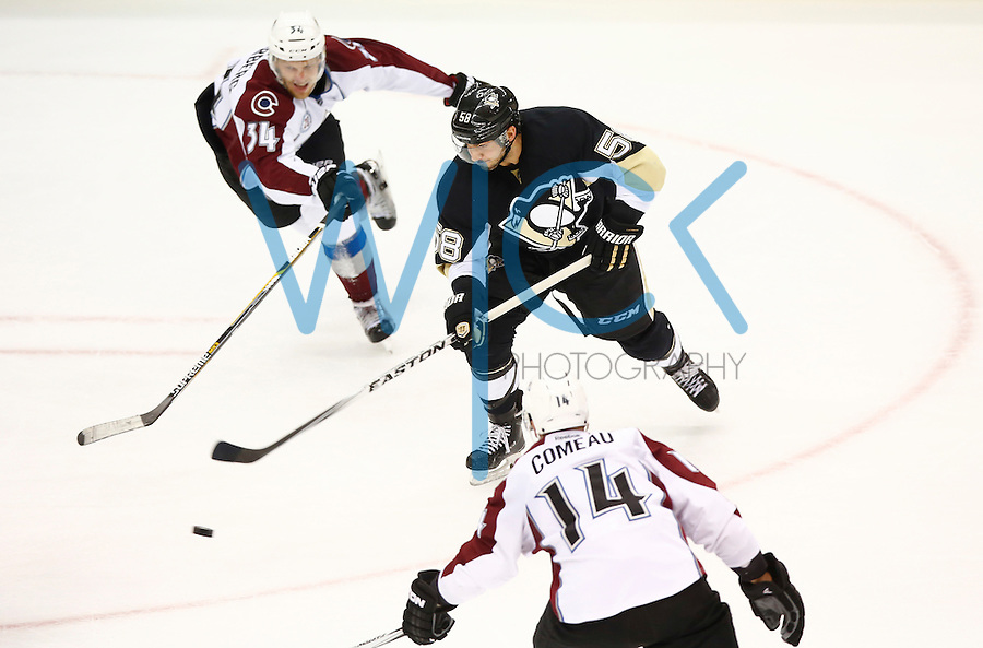 Kris Letang #58 of the Pittsburgh Penguins carries the puck in the second period in front of Carl Soderberg #34 of the Colorado Avalanche during the game at Consol Energy Center on November 19, 2015. (Photo by Jared Wickerham/DKPittsburghSports)