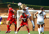 WINSTON-SALEM, NORTH CAROLINA - September 01, 2013:<br />  Charlyn Corral (9) of Louisville University loses a header to Sarah Teegarden (7) of Wake Forest University during a match at the Wake Forest Invitational tournament at Wake Forest University on September 01. The match was abandoned early in the second half due to severe weather with Wake leading 1-0.