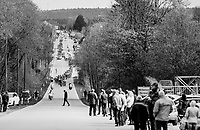 peloton cruising through the Ardennes with a jaywalker ahead<br /> <br /> 103rd Li&egrave;ge-Bastogne-Li&egrave;ge 2017 (1.UWT)<br /> One Day Race: Li&egrave;ge &rsaquo; Ans (258km)
