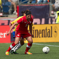 Canadian forward Melissa Tancredi (14) shields ball. In an international friendly, Canada defeated Brasil, 2-1, at Gillette Stadium on March 24, 2012.