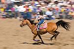A young girl barrel races at the Jordan Valley Big Loop Rodeo