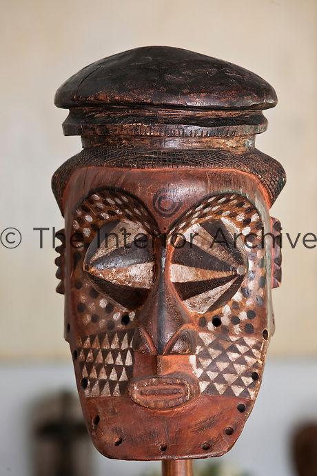 An intricate Congo mask called Kubakete,  part of a large collection displayed throughout the house