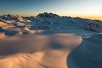 Vast area of Geikie Snowfield of upper parts of Franz Josef Glacier during setting sun with Mt. Tasman and Aoraki, Mount Cook dominating skyline, Westland Tai Poutini National Park, West Coast, UNESCO World Heritage Area, New Zealand, NZ