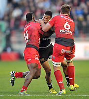 Anthony Watson of Bath Rugby is tackled by Josua Tuisova and Juan Smith of Toulon. European Rugby Champions Cup match, between RC Toulon and Bath Rugby on January 10, 2016 at the Stade Mayol in Toulon, France. Photo by: Patrick Khachfe / Onside Images
