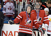 Ryan Ellis (Canada - 6), Martin Jones (Canada - 31) - Team USA celebrates after defeating Team Canada 6-5 (OT) to win the gold medal in the 2010 World Juniors tournament on Tuesday, January 5, 2010, at the Credit Union Centre in Saskatoon, Saskatchewan.