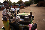 SPLA soldiers drive a truck they captured from SAF forces in the Nuba mountains. The SPLA has siezed dozens of trucks and and weapons form the SAF during fierce battles over key towns around the mountains.