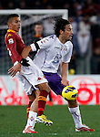 Calcio, Serie A: Roma vs Fiorentina. Roma, stadio Olimpico, 8 dicembre 2012..AS Roma defender Marquinhos, of Brazil, and Fiorentina forward Luca Toni, right, fight for the ball during the Italian Serie A football match between AS Roma and Fiorentina at Rome's Olympic stadium, 8 december 2012..UPDATE IMAGES PRESS/Isabella Bonotto