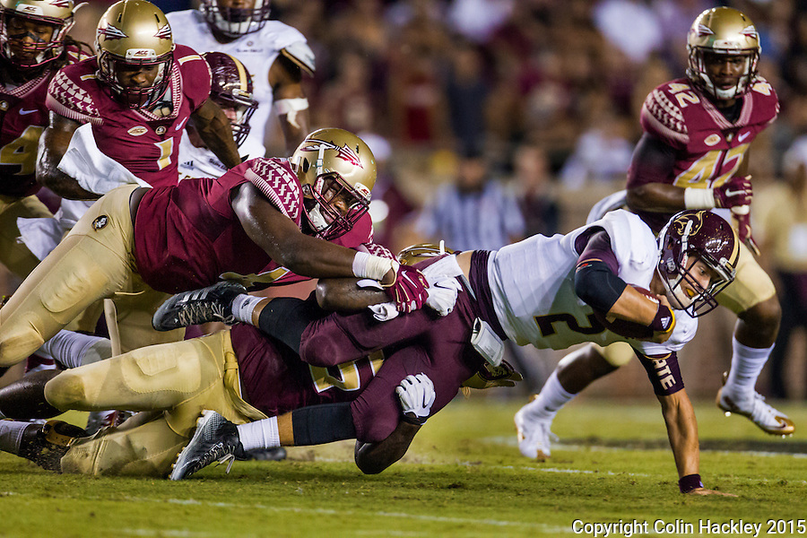 TALLAHASSEE, FLA. 9/5/15-Florida State University defenders Giorgio Newberry, left, and Reggie Northrup tackle Texas State University's Tyler Jones during first half action in the football game at Doak Campbell Stadium in Tallahassee.<br /> <br /> COLIN HACKLEY PHOTO