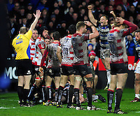 Chris Cook of Bath Rugby celebrates as team-mate Semesa Rokoduguni scores his second try of the match. Aviva Premiership match, between Gloucester Rugby and Bath Rugby on March 26, 2016 at Kingsholm Stadium in Gloucester, England. Photo by: Patrick Khachfe / Onside Images