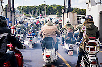 Scooterist's attending the Isle of Wight Scooter Rally leave the Ferry at Fishbourne, Isle of Wight, Britain - Aug 2014