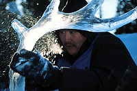 Ice sculptor carves giant blocks of ice during the World Ice Art Championships held each march in Fairbanks, Alaska,