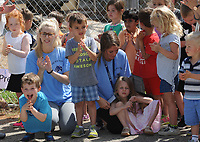 NWA Democrat-Gazette/ANDY SHUPE<br /> A group of students at The New School cheer Wednesday, April 19, 2017, during a beam raising and tour of the school's expansion project in Fayetteville. The New School hopes to open the facility in the fall for the 2017-18 school year.