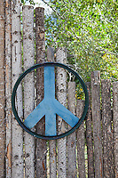 large handmade peace sign on a wooden fence
