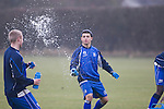Rochdale v Tranmere Rovers preparations, 31/12/2010. Prenton Park, League 1. Two Tranmere Rovers players squirting water at each other during a break in training at the club's Raby Mere training ground, as the club prepare for the following day's Npower League 1 fixture away to Rochdale. It was the first league fixture between the teams since March 1989. Rochdale won this latest encounter by three goals to two watched by a crowd of 5,500. Photo by Colin McPherson.