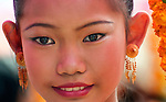The face of a girl participating in the Lao New Year, (Pi Mai) parade in Luang Prabang, Laos.