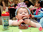 SOUTHBURY, CT.-31 DECEMBER 2009-123109DA03- Miles Montello, 2, takes a bite of his cupcake during a &quot;Happy Noon Year&quot; fundraiser sponsored by the Southbury Juniorettes held at the Southbury Parks &amp; Recreation Building Thursday. Children enjoyed lunch, games, crafts, New Year hats, leis, glasses, tattoos and a countdown to 12 p.m.<br /> <br /> <br />  Darlene Douty Republican-American