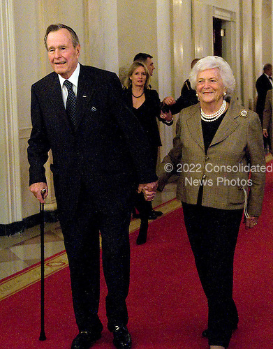 Washington, DC - January 7, 2009 -- Former United States President George H.W. Bush and former first lady Barbara Bush arrive to make remarks at Reception in Honor of the Points of Light Institute in the East Room of the White House in Washington, D.C. on Wednesday, January 7, 2009..Credit: Ron Sachs / CNP