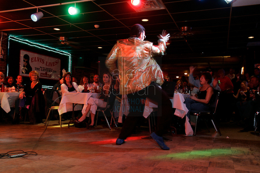 Mike Jones entertains people as Elvis Presley at The Lantern Inn, his family's restaurant in Gainesville, Ga., on Saturday, Dec. 16, 2006. Jones, who is 46 and a cook, has been performing as Elvis at the eatery for 18 years, but Saturday was the curtain call. The Lantern Inn closed its doors on Sunday after 41 years of business.<br />