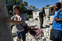 Andy Chaggar and EDV staff assessing the site of a damaged orphanage with members of the community, Port-au-Prince, Haiti. EDV is committed to affecting permanent change in disaster-affected communities worldwide. Their role is to facilitate personal connections between volunteers and the survivors of disasters.  The charity is based on a proven model developed by several landmark organisations that have paved the way for citizens to become disaster volunteers. These landmark organisations have shown that supposedly ordinary people working together with the guidance of knowledgeable leaders can make an extraordinary difference in the lives of those affected by disaster..EDV believe that to provide meaningful relief and reconstruction assistance to disaster affected communities they have to do more than reconstruct buildings. They need to understand and address the factors that made a community vulnerable to the disaster in the first place. The charity's work is organised with these factors in mind so that they can affect change that far outlives their presence..EDV believes that survivor motivation is essential to the recovery of any disaster-affected community. Their operations will always be predicated on the idea that survivors may be traumatised, but they are not helpless. With this in mind, EDV encourages host communities to direct their own recovery. EDV believe that this empowerment is essential in helping survivors feel a renewed sense of control over their lives which will, in turn, help overcome the feelings of hopelessness that can follow a disaster and inhibit long term recovery. EDV also believe that social cohesion is of primary importance in any disaster-affected area. No amount of bricks or mortar will bring about sustainable improvement if communities fail to come together or are disrupted by relief efforts. Therefore, their operations will always aim to foster communication and cooperation within and between the communities they serve.